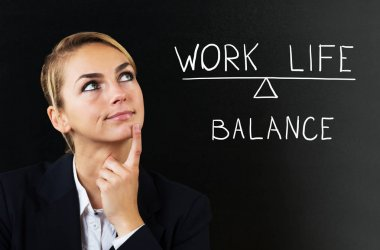 Businesswoman Thinking About Balancing