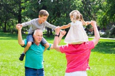 Piggyback Ride With Grandchildren