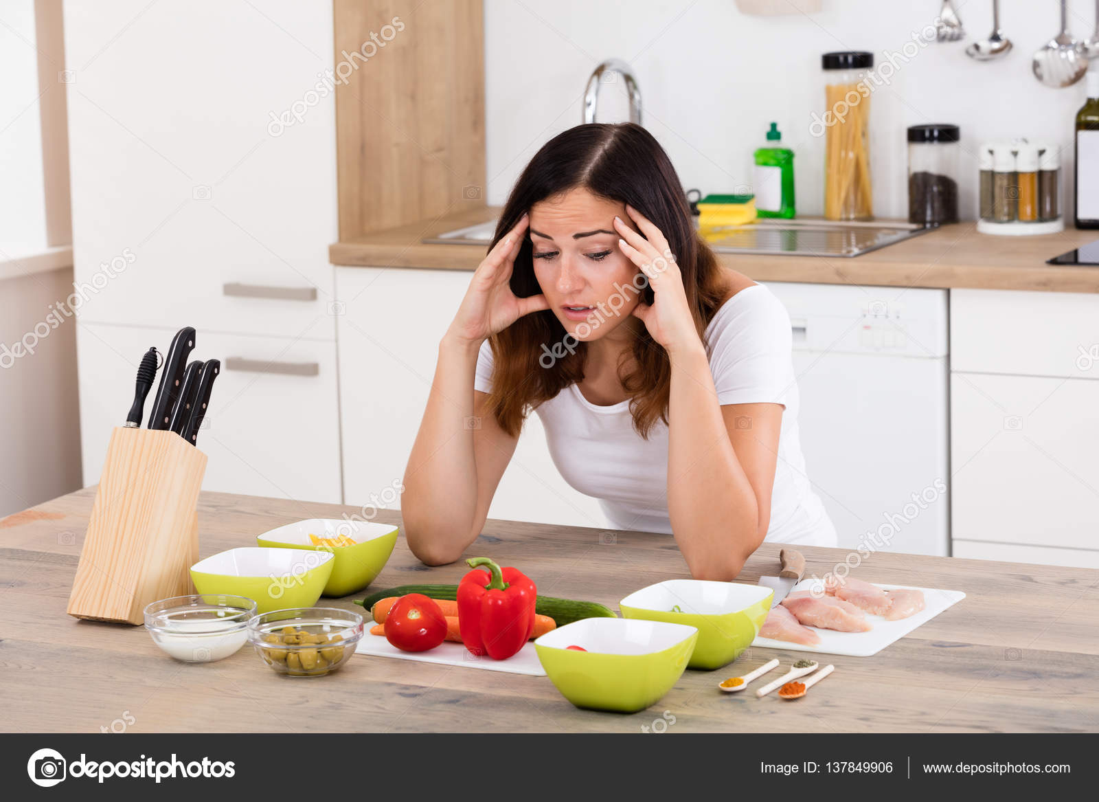 unhappy woman in kitchen stock photo andreypopov 137849906