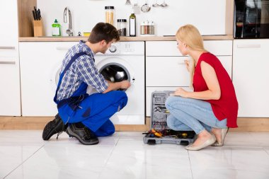 Worker Checking Washing Machine
