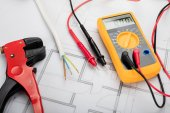 Photo Digital Multimeter On Blueprint
