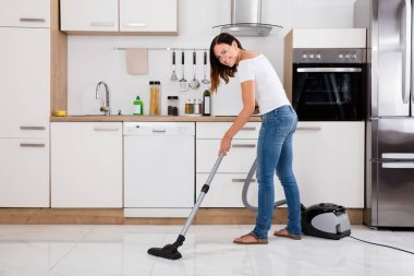 Woman Using Vacuum Cleaner