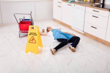 Housemaid Lying On Floor