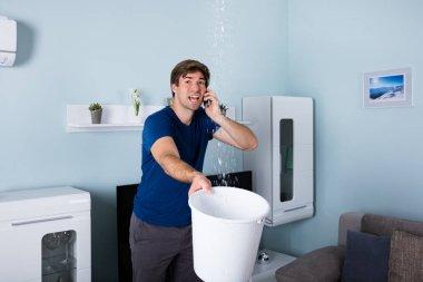 Man Calling Plumber