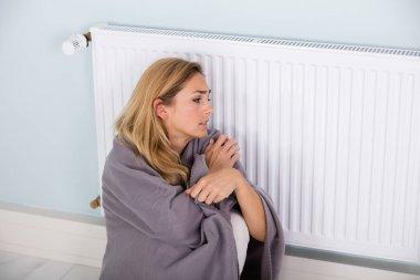 Woman Sitting Near Thermostat
