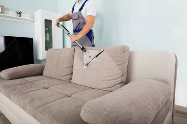 Worker Cleaning Sofa
