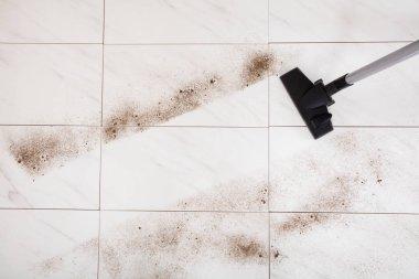 Vacuuming Dust Of Floor