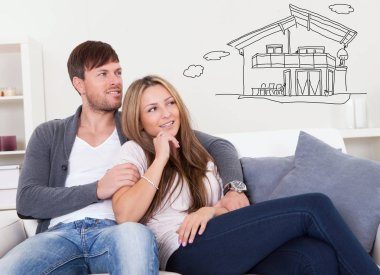 Couple Thinking Of Own House