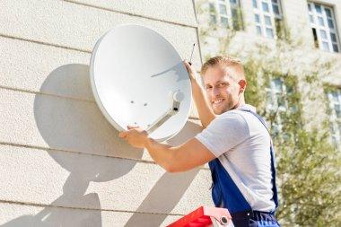 Man Fitting TV Dish