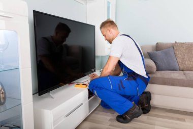 Electrician Fixing Television