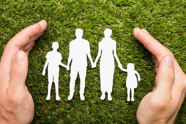 Person Protecting Family Papercut