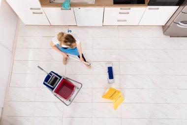 Housemaid Mopping Floor