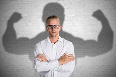 Businessman With Muscular Shadow