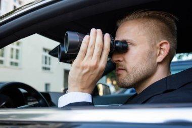 Detective Sitting Inside Car