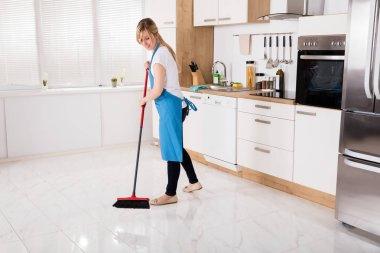 Housemaid Sweeping Floor