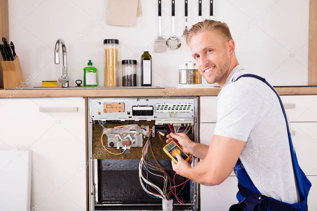 Technician Checking Dishwasher