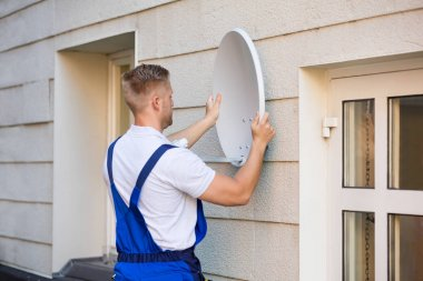 Technician Installing TV Dish