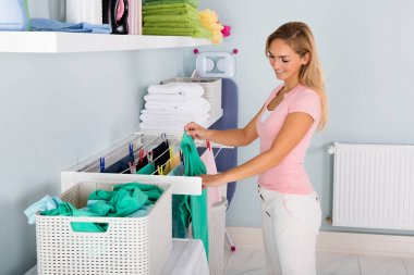 Woman Hanging Wet Clothes