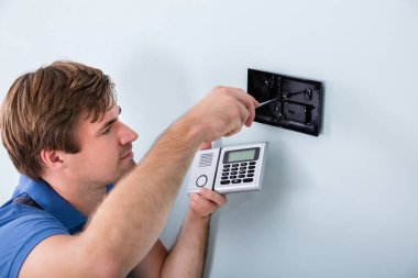 Technician Installing Security System
