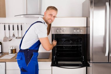 Technician Repairing Oven