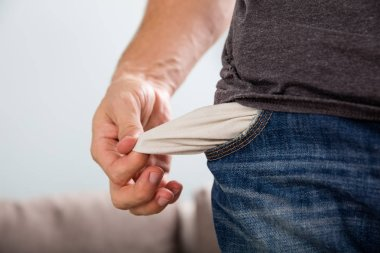 Man Showing Empty Pocket