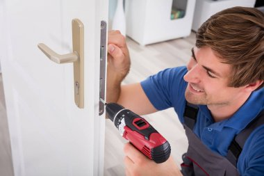 Carpenter Installing Door Lock