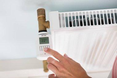 Person Adjusting Temperature
