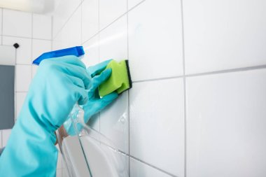 person cleaning Tile