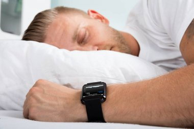 Man Sleeping With Smart Watch