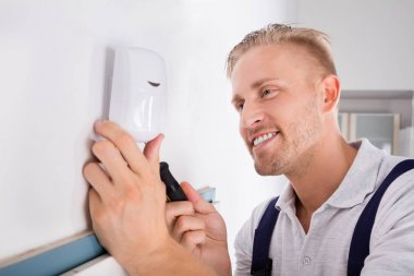 Electrician Installing Motion Detector