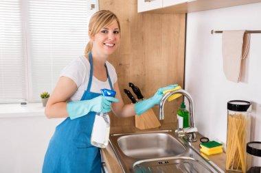 Woman Cleaning Steel Sink