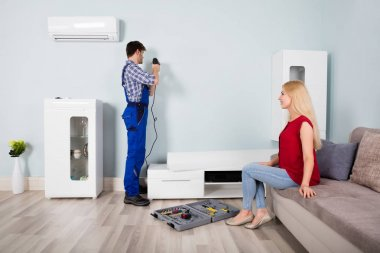 Male Carpenter Installing Furniture