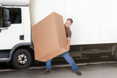 Delivery Man Holding Heavy Box