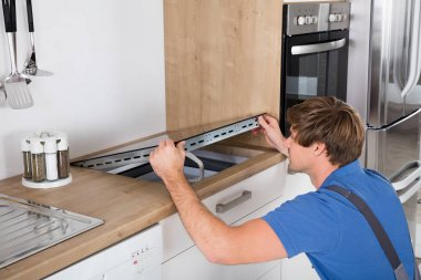 Man Installing Induction Stove