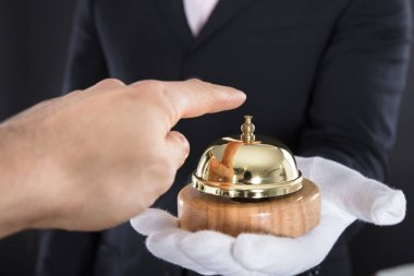 male Hand Ringing Service Bell