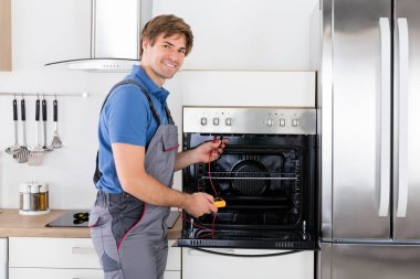 Technician Checking Oven