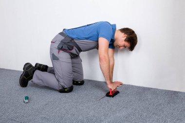 Worker Lying Carpet