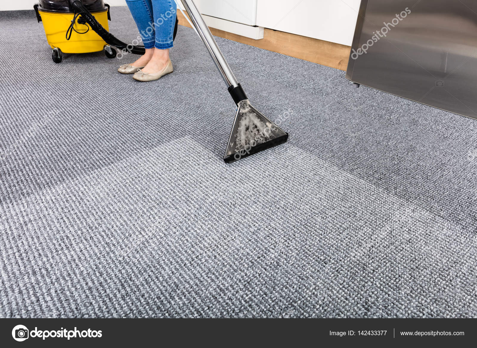 Close Up Of Woman Cleaning Carpet With Vacuum Cleaner Photo By AndreyPopov