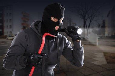 Burglar With Crowbar And Flashlight