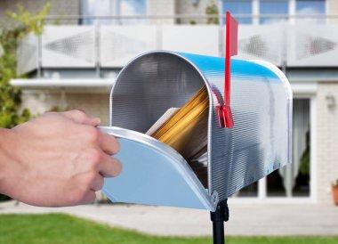 Hand Checking Mailbox