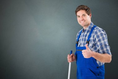 Janitor with thumb up