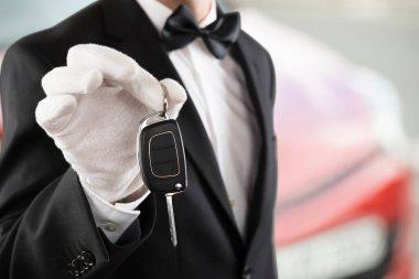 Valet Boy Holding Car Key