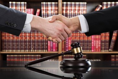 Gavel With Shaking Hands