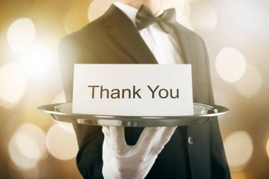 Waiter Holding Thank You Card