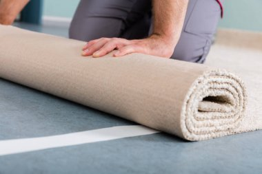 Hands Rolling Carpet