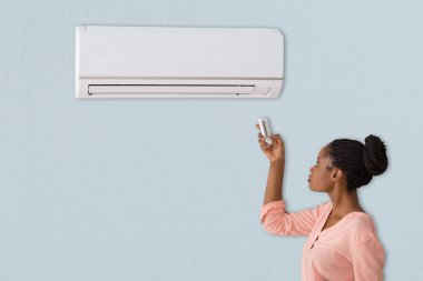 woman using air conditioner