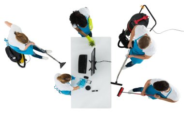 High Angle View Of Janitors Cleaning Office On White Background