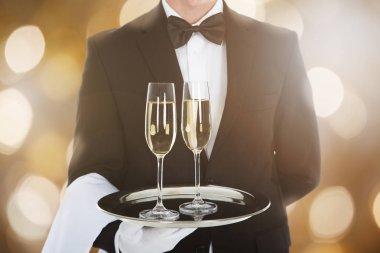 Waiter Serving Glasses Of Champagne