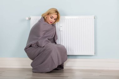 Woman With Blanket Suffering From Cold