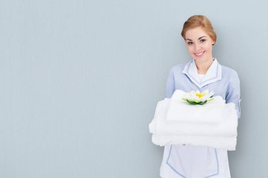 Young Maid Holding Towels